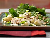 Asian spinach salad with a chicken fillet and a peanut vinaigrette