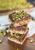 A stack of pistachio and chocolate slices
