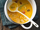 Pumpkin and carrot soup with baked apple and cheddar cheese