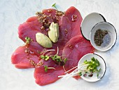 Tuna carpaccio with avocado cream and sesame seeds