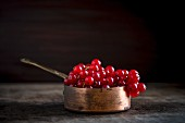 Redcurrants in a copper saucepan