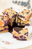 Blueberry cake slices with a chocolate sauce