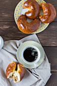 Crescent-shaped walnut pastries and a cup of coffee