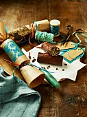 Chocolate and dried fruit rolls in Christmas cracker wrappings