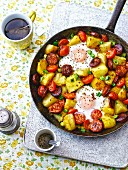 Baked eggs, chorizo, potatoes and tomatoes