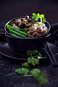 Vegan red quinoa and rice with wild mushrooms, soya chunks, snow peas and black sesame
