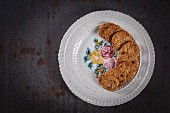 Oat, coconut and goji berry cookies arranged on a plate