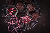 Christmas chocolate and walnut cookies wrapped in gift ribbon with a bauble decoration