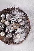 A bowl of antique silver baubles