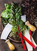 Variety of fresh chard mangold salad leaves on wooden chopping board
