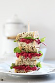Stacked sandwiches with beetroot and lettuce