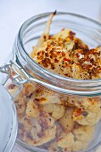 Oven-roasted cauliflower in a flip-top glass jar for a picnic