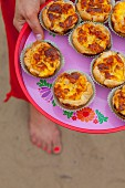 Puff pastry muffins with ham and cheese for a beach picnic