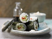 Maki sushi with cucumber, avocado, lettuce and peppers