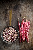 Shelled and Whole Borlotti Beans on Wooden Board