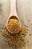 Whole buckwheat bran seeds on wooden spoon