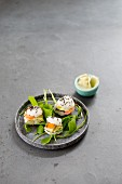 Three mini sushi burgers with purslane and ginger in a bowl