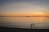 A beach by sunset on the island of Öland in the south of Sweden