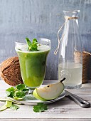 Pear and cucumber smoothie with coconut water and fresh coriander