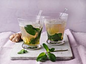 Orange and ginger cocktail with mint and ginger ale