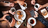 Friends having coffee together in cafe