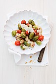 Basil gnocchi with cherry tomatoes and white beans