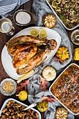 A roast turkey with side dishes for Thanksgiving