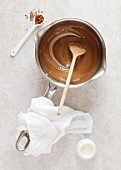 Coffee custard in a saucepan (top view)