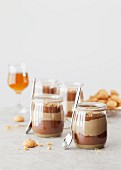 Layer dessert with coffee and chocolate cream in glasses