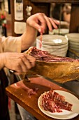 Freshly sliced ham at the 'Taberna La Dolores' in Madrid, Spain