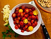 Sliced cherry tomatoes in bowl