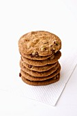 Stack of chocolate chip cookies on a white napkin