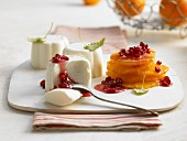 White chocolate and yoghurt mousse with oranges and pomegranate seeds