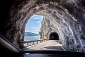 A tunnel on the SP 38 road along the shore of Lake Garda in Italy