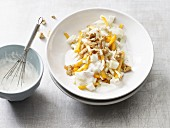 Fennel salad with walnuts, persimmon and a honey and yoghurt dressing (low lactose)