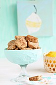 Gluten-free cookies with buckwheat flour and coconut blossom sugar, with lemons in a basket