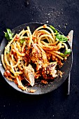 Roasted chicken breast with macaroni in a creamy tomato sauce (soul food)