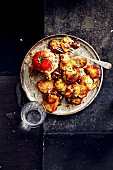 Fried potatoes with rosemary and a tomato filled with cheese (soul food)