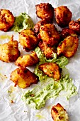 Fried potato puffs with avocado mayonnaise (soul food)