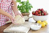 Yeast dough, strawberries, flour, lemons and basil