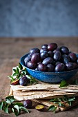 Freshly picked plums in a bowl