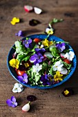 Spring salad with radishes and edible flowers