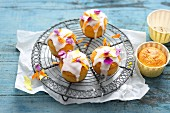 Small coconut and banana cakes with edible flowers