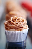 A cupcake with chestnut icing