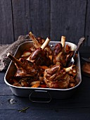 Braised lamb shanks in a roasting tray