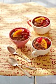 Chocolate mousse with cranberry jam and orange