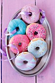 Doughnuts with brightly coloured icing and sugar sprinkles