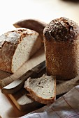 Fresh black bread on a chopping board