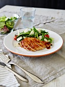 Bbq chicken breast green salad caperdressing