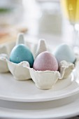 Dyed Easter eggs in egg carton